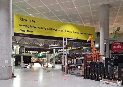 Idealista en el friso de llegadas del Aeropuerto de Málaga